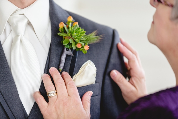 Custom succulent boutonnieres featuring coral coloured berries and a hint of wheat - photo by James Cripps