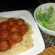 Spaghetti and meatballs with a depressing side of salad.